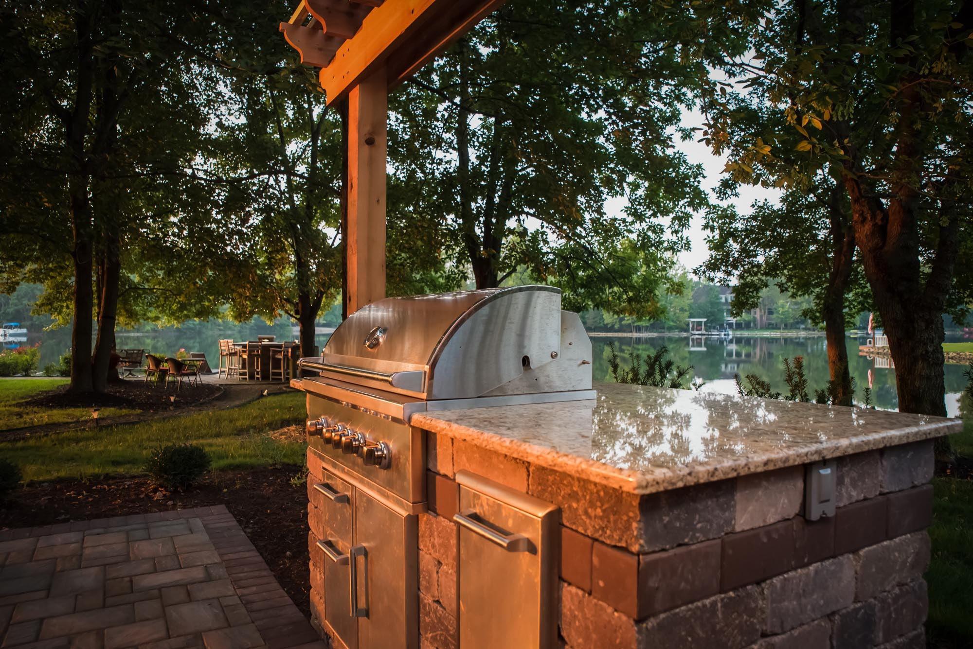 Calvin landscape Cyote stainless steel grill with granite top