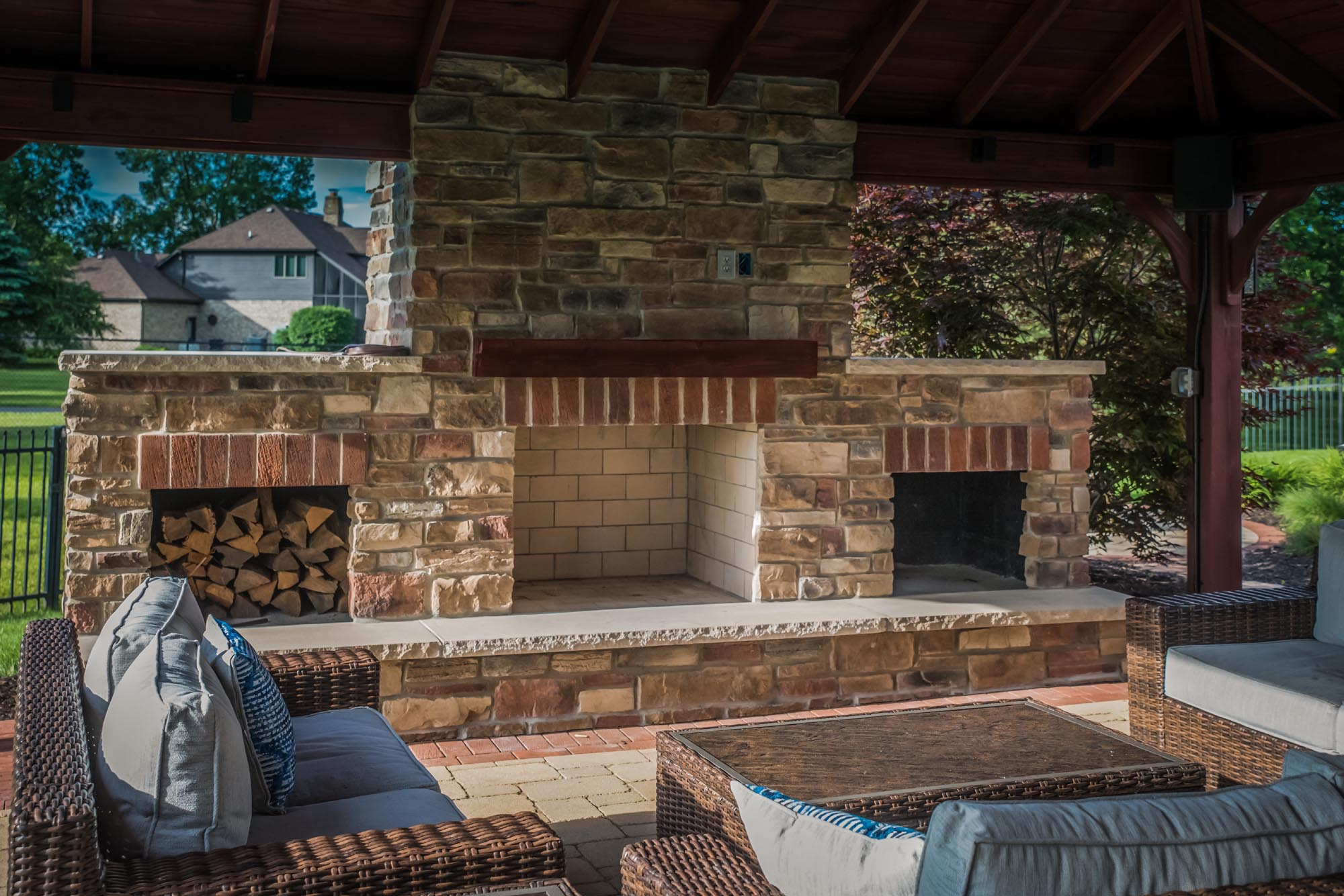 Calvin landscape masonry stone and brick outdoor fireplace