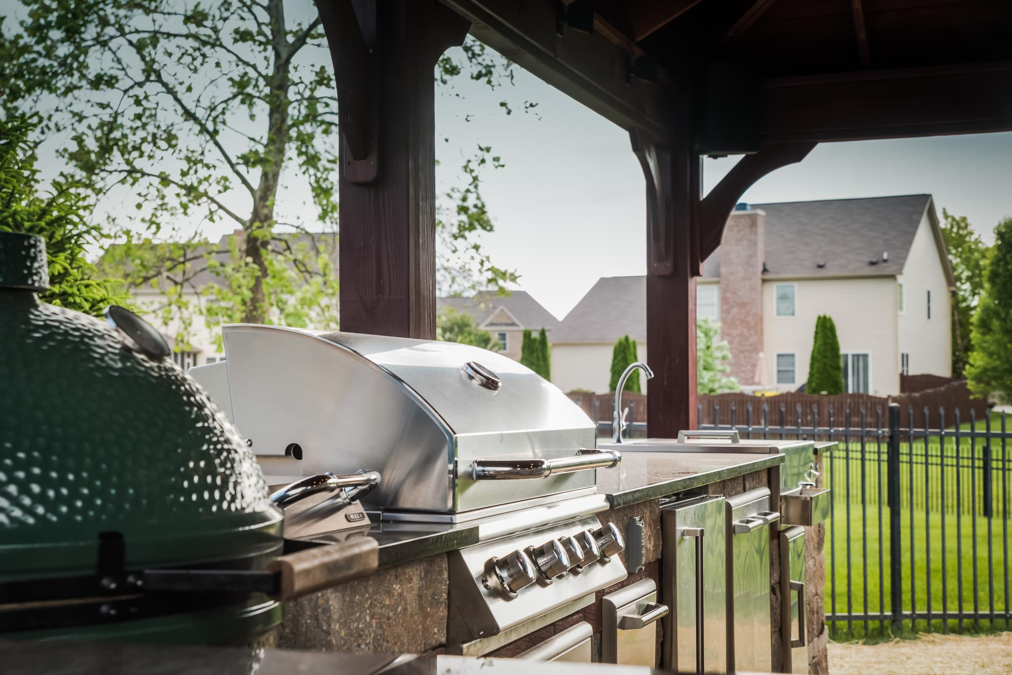Calvin landscape built in gas grill and Big Green Egg